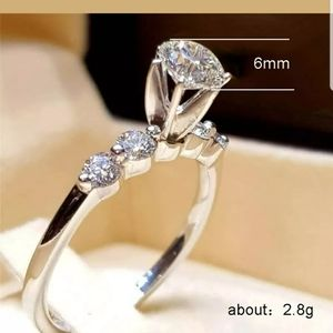 Brand new white sapphire silver plated ring